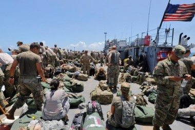 The deck of a U.S. Navy landing craft is crowded with Army soldiers and their belongings as they are evacuated in advance of Hurricane Maria, off St. Thomas shore, U.S. Virgin Islands September 17, 2017. Picture taken September 17, 2017.  REUTERS/Jonathan Drake - RC1944D98700