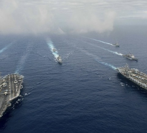 The Nimitz-class aircraft carriers USS John C. Stennis (CVN 74), and USS Ronald Reagan (CVN 76) (R) conduct dual aircraft carrier strike group operations in the U.S. 7th Fleet area of operations in support of security and stability in the Indo-Asia-Pacific in the Philippine Sea on June 18, 2016.   Courtesy Jake Greenberg/U.S. Navy/Handout via REUTERS   ATTENTION EDITORS - THIS IMAGE WAS PROVIDED BY A THIRD PARTY. EDITORIAL USE ONLY - TM3EC6I16BV01